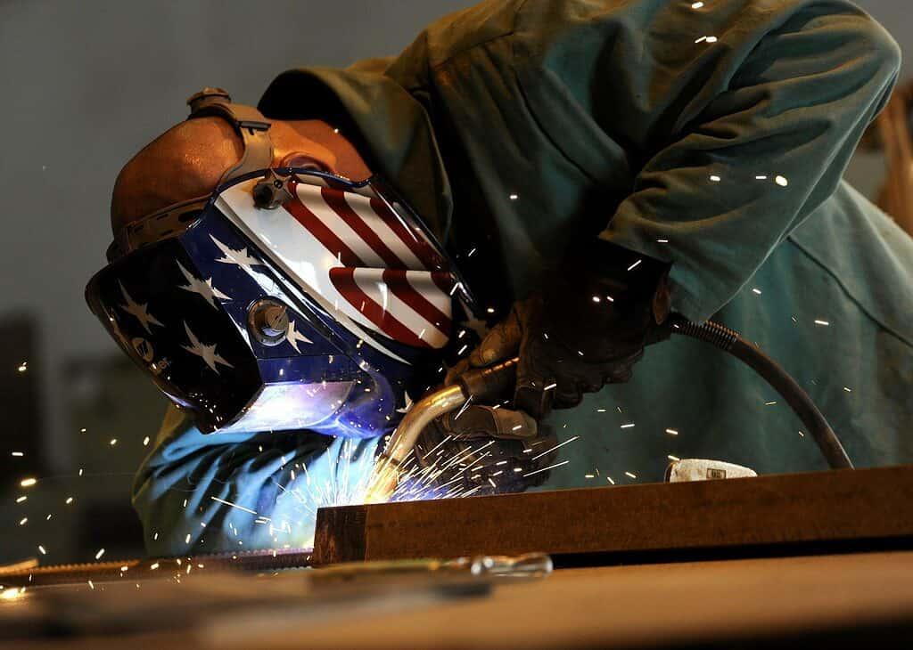 Welding using an auto-darkening helmet.