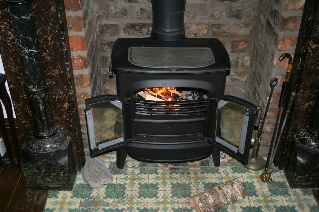 A black, painted wood stove is shown in this file photo.