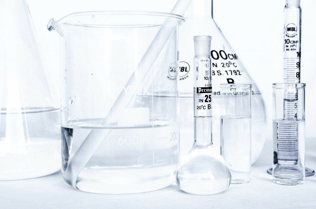 A laboratory where beakers and vials are shown for testing the composition of paints such as acryclic.