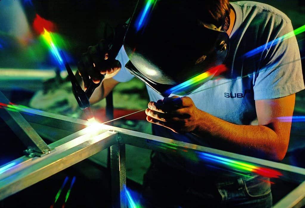 A welder uses a budget welding mask.
